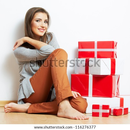 Woman portrait in christmas style with red, white box gift seat, isolated on white background. - stock photo