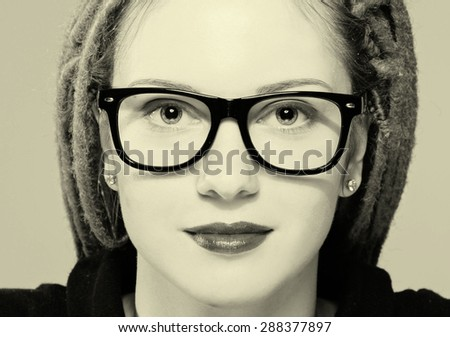 Woman portrait in glasses with dreadlocks hipster black and white - stock photo