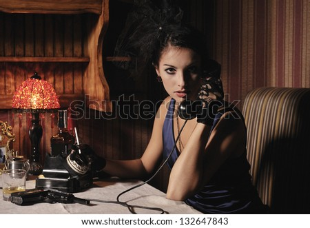 Woman portrait  in retro style with phone and cigarette. - stock photo