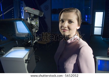 woman portrait in tv studio - stock photo