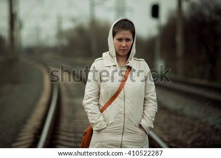 woman portrait on railway - stock photo