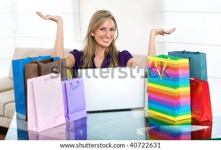 Woman portrait smiling shopping online with bags - stock photo