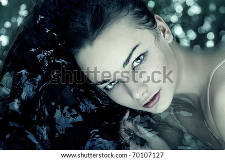 Woman portrait swimming in water close up - stock photo