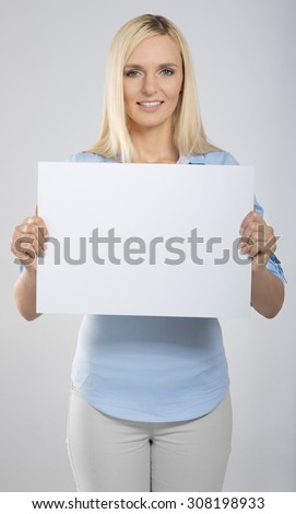 woman portrait with blank white signboard - stock photo