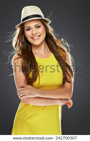 woman portrait with crossed arms . yellow dress . long hair . - stock photo