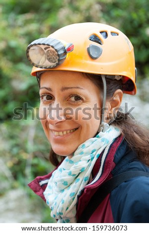 Woman portrait with helmet for cave exploration.  - stock photo