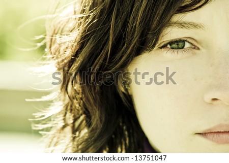 Woman portrait with impressive green eye. - stock photo