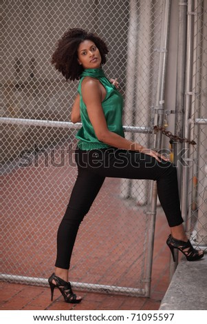 Woman posing in an urban setting - stock photo