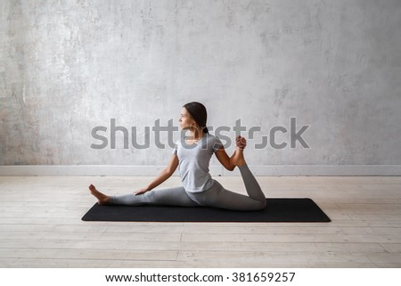 Woman practicing advanced yoga. A series of yoga poses - stock photo