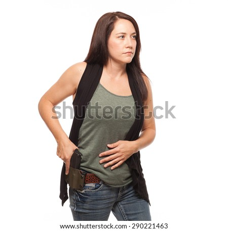 Woman Practicing Gun Safety and about to draw gun from holster | Attractive female shooter holding handgun against white background. - stock photo