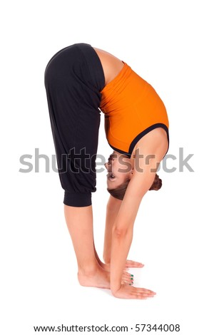 Woman practicing yoga exercise called Standing Forward Bend, sanskrit name: Uttanasana, this posture stretches the back of the legs, hips, spine, good as a back pain relief - stock photo