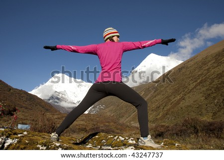 Woman practicing yoga in the mountains - stock photo
