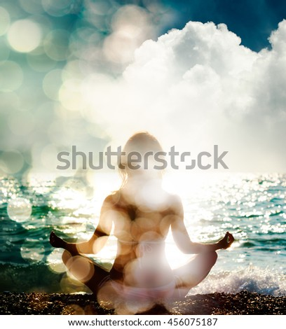 Woman Practicing Yoga on Nature Background - stock photo
