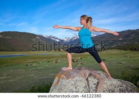 Woman pratices Yoga in the Colorado Rocky Mountains - stock photo