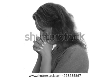 Woman praying isolated on a white background - stock photo