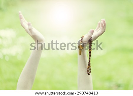 Woman Praying to God with her hands up. Religious concept. - stock photo