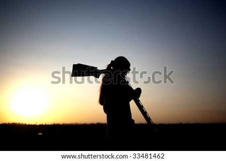 Woman preparation for shooting with his gun silhouette - stock photo