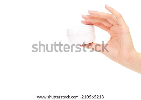 Woman presenting a hand cream - stock photo