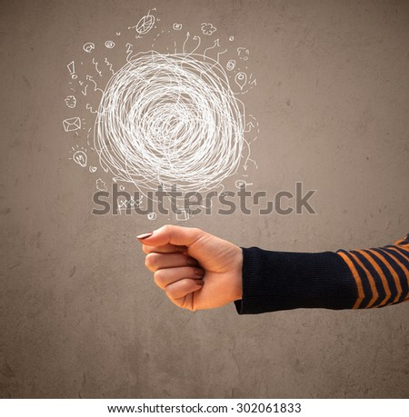 Woman presenting chaos concept in her palm - stock photo