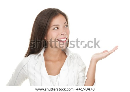 Woman presenting your product in her open hand / palm.  Casual beautiful young mixed race chinese / caucasian businesswoman isolated on seamless white background - stock photo