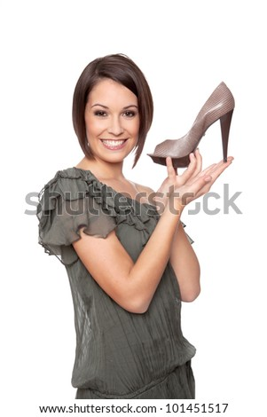 Woman presents her shoe like a pro on a shopping TV channel - stock photo