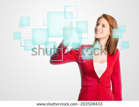 Woman pressing a modern digital panel - stock photo