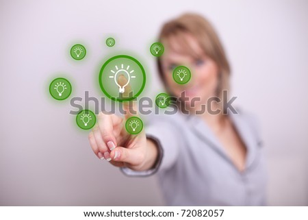 Woman pressing idea button with one hand - stock photo