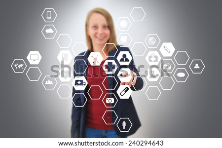 Woman pressing modern touch screen buttons - stock photo