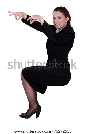 Woman pretending to be puppet master - stock photo