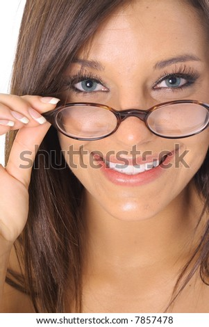 woman pulling glasses with a gorgeous smile - stock photo