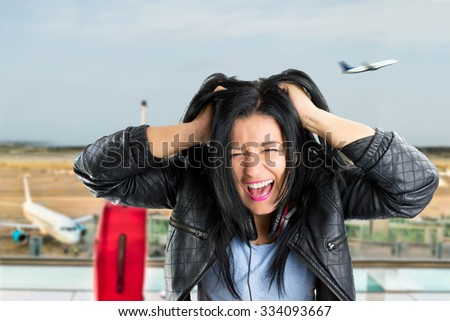 woman pulling their hair and angry because I missed the plane - stock photo