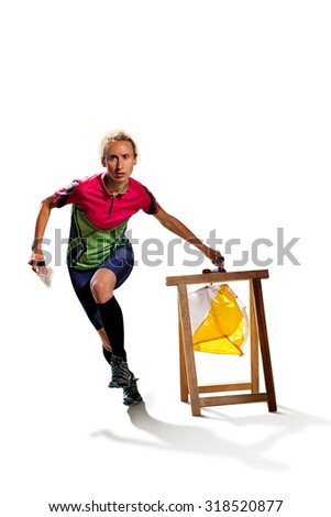 Woman punching at control point, taking part in orienteering competitions. Isolated on white. File contains clipping path of woman and shadows - stock photo