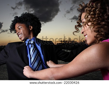 Woman pushing her man - stock photo