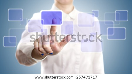 woman pushing on a touchscreen interface - stock photo