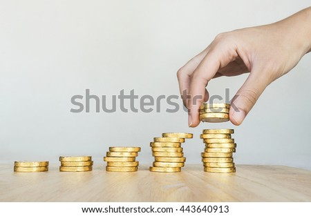 woman put coins to stack of coins, Saving money concept - stock photo