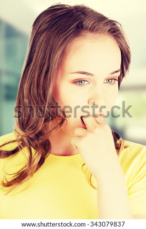 Woman putting her finger in mouth to provoke vomiting - stock photo