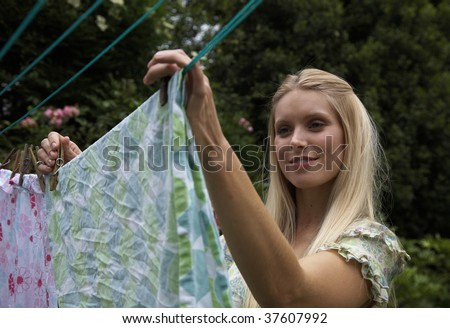 woman putting out the washing to dry - stock photo