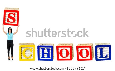 Woman raise letter from word School - stock photo