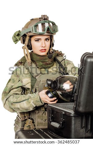 woman ranger selects the gear before the battle - stock photo