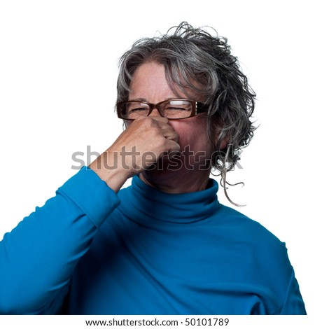 Woman reacts to a very bad smell - stock photo