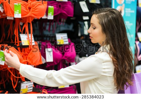 Woman reading a price tag - stock photo