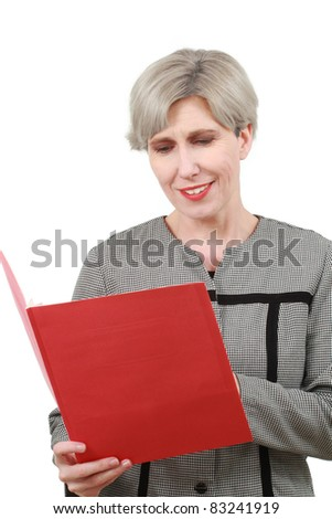 Woman reading a red folder - stock photo