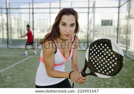 Woman ready for play paddle tennis in outdoors court - stock photo