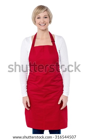 Woman ready to cook, wearing apron - stock photo