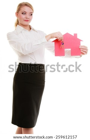 Woman real estate agent holding red paper house and keys. Property business and accomodation or home buying ownership concept, isolated on white background - stock photo