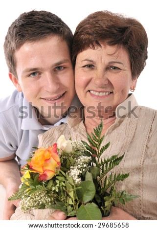 woman receives a bunch of flower from her grandchild - stock photo