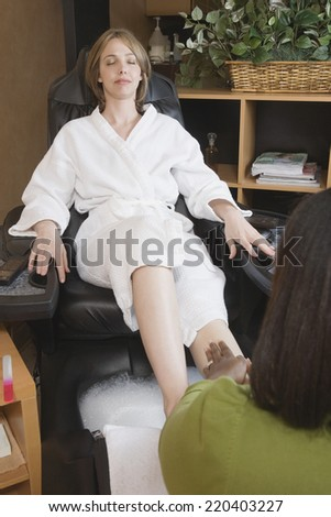 Woman receiving spa pedicure - stock photo