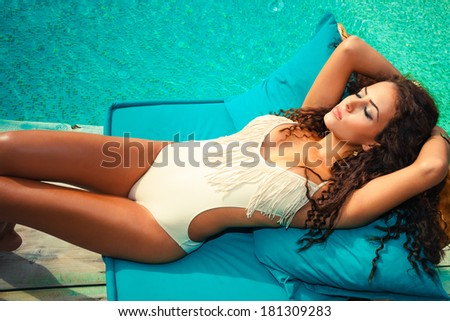 woman relax  by the pool take sunbath sunny summer day - stock photo
