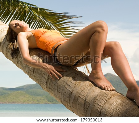 woman relax on the palms - stock photo