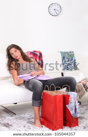 woman relaxing after shopping - stock photo